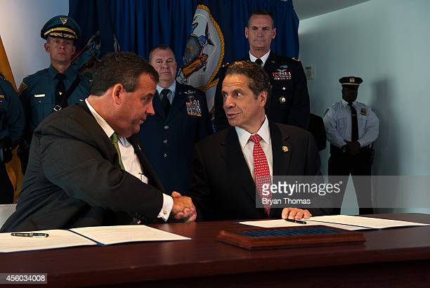 New Jersey Gov Chris Christie and New York Governor Andrew Cuomo shake hands after signing a memorandum of understanding for increasing security in...