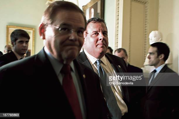 New Jersey Gov Chris Christie and Sen Robert Menendez walk through the US Capitol after a meeting with Senate Majority Leader Harry Reid December 6...
