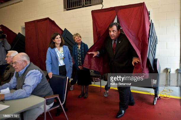 New Jersey Gov Chris Christie exits a voting booth after casting his ballot for New Jersey governor in the general election as his wife Mary Pat...