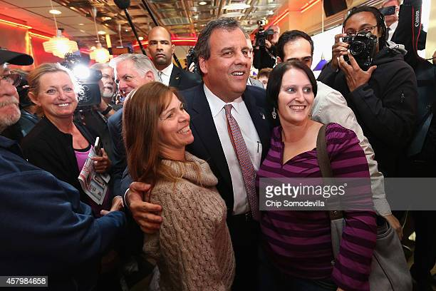 New Jersey Gov. Chris Christie poses for photographs during a campaign stop with Maryland Republican gubernatorial candidate Larry Hogan at the Honey...