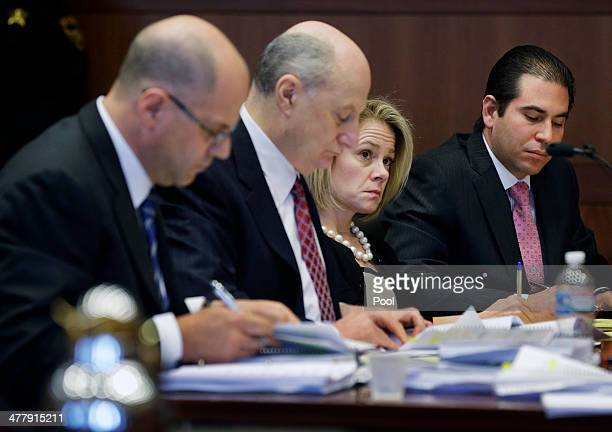 New Jersey Gov Chris Christie's former Deputy Chief of Staff Bridget Anne Kelly sits with attorneys Kevin H Marino Michael Critchley and attorneys...