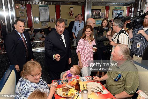 New Jersey Governor and Republican presidential candidate Chris Christie and wife Mary Pat greet people at Mary Ann's Diner July 3 2015 in Derry New...