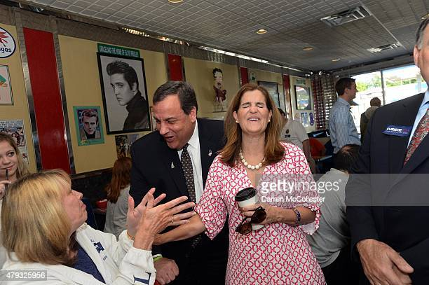 New Jersey Governor and Republican presidential candidate Chris Christie and wife Mary Pat speak with Pollyann Winslow at Mary Ann's Diner July 3...