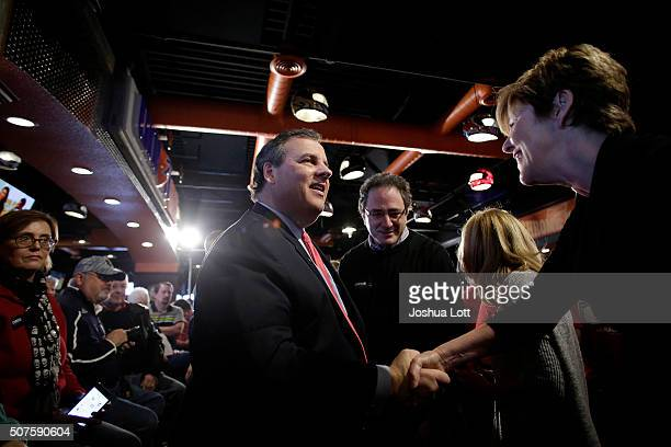 New Jersey Governor and Republican presidential candidate Chris Christie greets people as he arrives at the Chrome Horse Saloon Slop House during a...