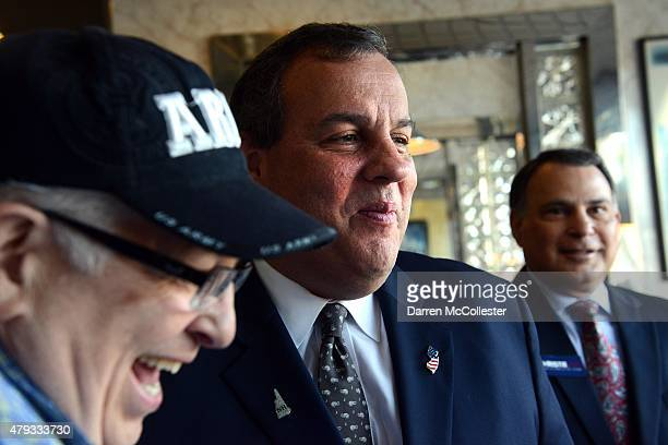 New Jersey Governor and Republican presidential candidate Chris Christie greets people at Mary Ann's Diner July 3 2015 in Derry New Hampshire...