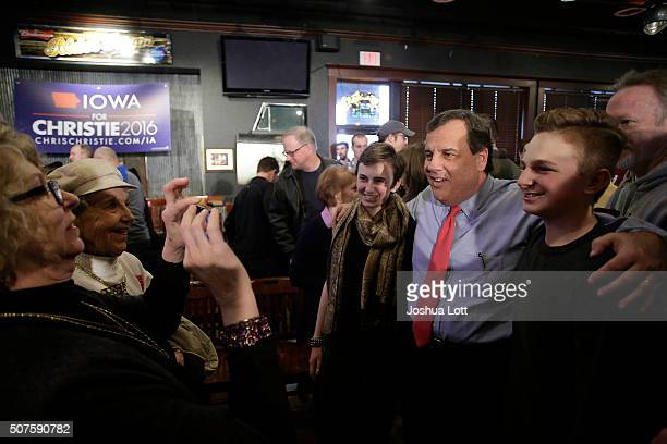 New Jersey Governor and Republican presidential candidate Chris Christie poses for a picture as he greets people during a campaign event at the...