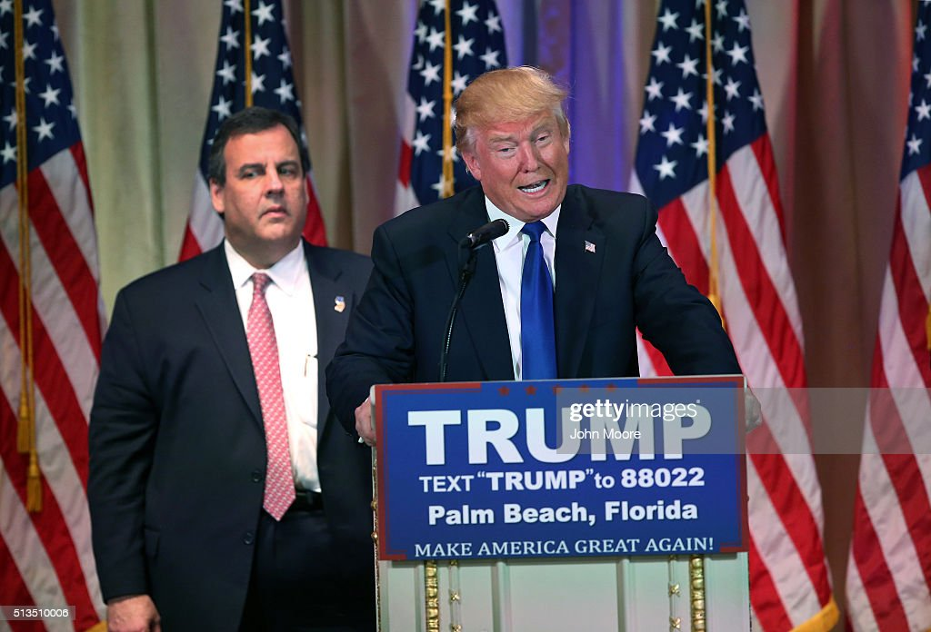 New Jersey Governor Chris Christie accompanies Republican Presidential frontrunner Donald Trump on the stage at a press conference on March 1, 2016 in Palm Beach, Florida. Christie stood by, often distracted, as Trump held a press conference at his Mar a Lago Club after the polls closed on Super Tuesday.