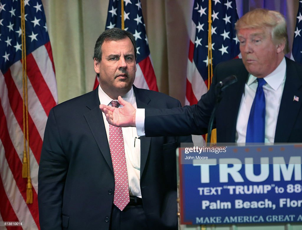 New Jersey Governor Chris Christie accompanies Republican Presidential frontrunner Donald Trump off the stage after a press conference on March 1, 2016 in Palm Beach, Florida. Christie stood by as Trump held a press conference at his Mar a Lago Club after the polls closed in a dozen states nationwide on Super Tuesday.