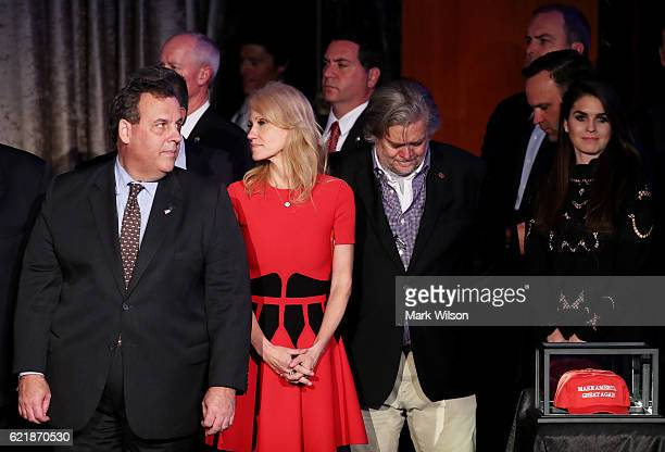 New Jersey Governor Chris Christie acknowledges the crowd along with Republican presidentelect Donald Trump's campaign manager Kellyanne Conway and...