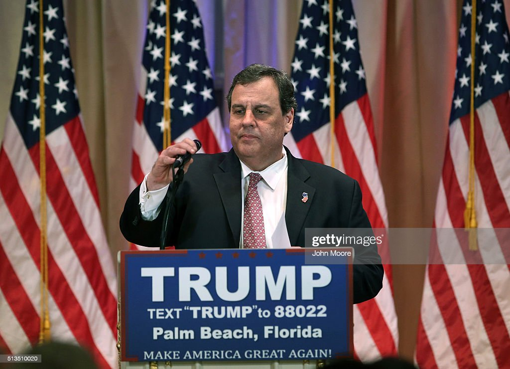 New Jersey Governor Chris Christie adjusts a microphone before introducing Republican Presidential frontrunner Donald Trump for a press conference on March 1, 2016 in Palm Beach, Florida. Christie stood by, often distracted, as Trump addressed the media at his Mar a Lago Club after the polls closed on Super Tuesday.