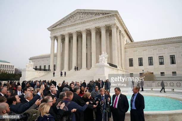 New Jersey Governor Chris Christie and attorney Ted Olson speak to members of the media as looks on in front of the US Supreme Court December 4 2017...