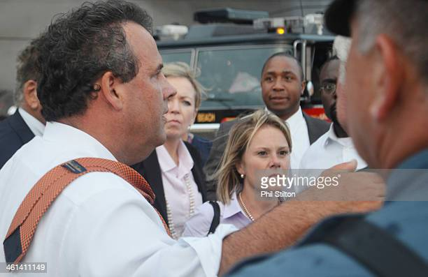 New Jersey Governor Chris Christie and Deputy Chief of Staff Bridget Anne Kelly stand at the scene of a boardwalk fire September 12, 2013 in Seaside...