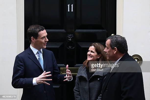 New Jersey Governor Chris Christie and his wife Mary Pat Christie are greeted by Britain's Chancellor Of The Exchequer George Osborne in Downing...