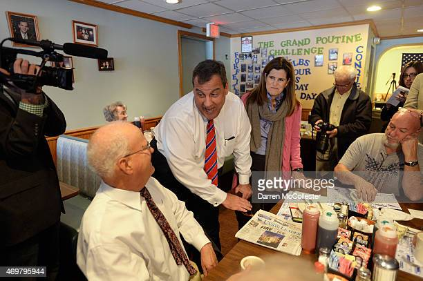 New Jersey Governor Chris Christie and his wife Mary Pat Foster greet diners at Chez Vachon April 15 2015 in Manchester New Hampshire The governor is...