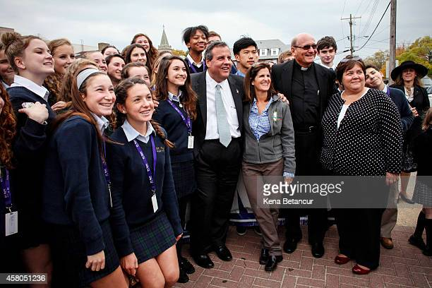 New Jersey Governor Chris Christie and his wife Mary Pat pose for a picture with students of Saint Rose Hight School during a visit to Belmar two...