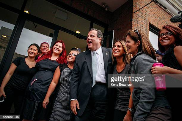 New Jersey Governor Chris Christie and his wife Mary Pat pose for a picture with workers of Pasoh Salon during a visit to Belmar two years after...