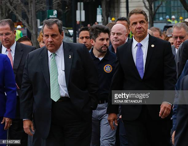 New Jersey Governor Chris Christie and New York Governor Andrew Cuomo arrive at a press conference outside the New Jersey transit rail station in...