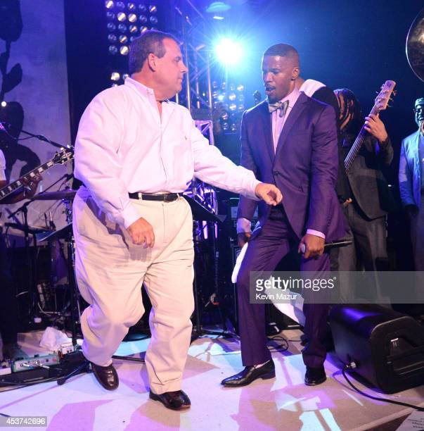 New Jersey Governor Chris Christie dances onstage with Jamie Foxx at Apollo in the Hamptons at The Creeks on August 16 2014 in East Hampton New York