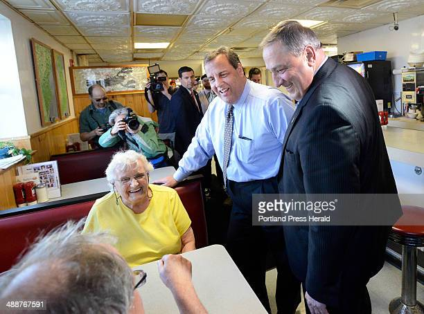 New Jersey Governor Chris Christie joins Maine Governor Paul LePage talking with Gertrude Byard and her son Rich Byard from Portland as they visit...