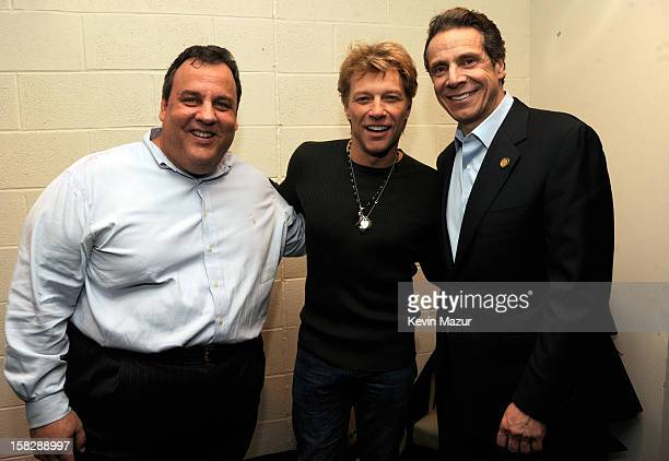 New Jersey Governor Chris Christie Jon Bon Jovi and New York Governor Andrew Cuomo backstage during '121212' a concert benefiting The Robin Hood...