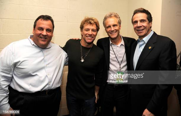 New Jersey Governor Chris Christie Jon Bon Jovi John Sykes and New York Governor Andrew Cuomo backstage during '121212' a concert benefiting The...