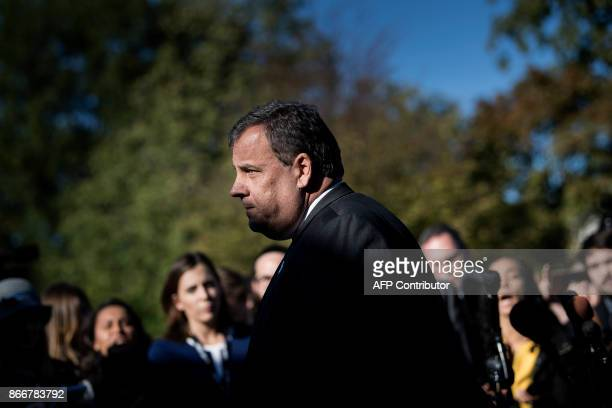 New Jersey Governor Chris Christie leaves after speaking to reporters outside the White House in Washington DC on October 26 2017 / AFP PHOTO /...