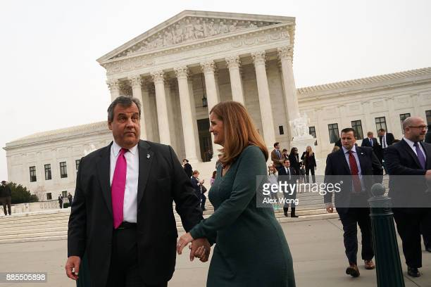New Jersey Governor Chris Christie leaves the US Supreme Court with his wife Mary Pat Christie December 4 2017 in Washington DC The Supreme Court was...