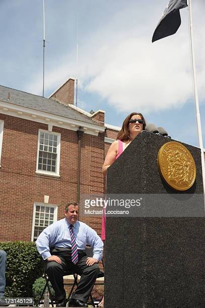 New Jersey Governor Chris Christie looks on as wife Mary Pat Foster addresses atttendees during the Hurricane Sandy New Jersey Relief Fund Press...