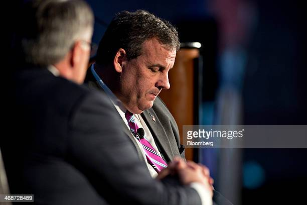 New Jersey governor Chris Christie right pauses while speaking with Gregory Greg Brown chairman and chief executive officer of Motorola Solutions Inc...