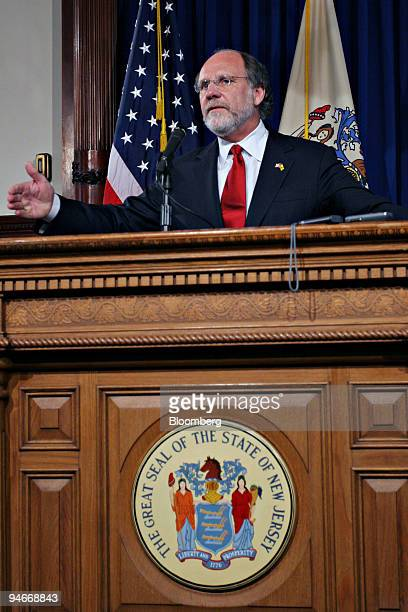 New Jersey Governor Jon Corzine gestures as he speaks to reporters at the State House in Trenton New Jersey Monday July 3 2006 Corzine kept state...