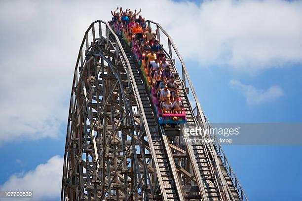 USA, New Jersey, Jackson, People on rollercoaster