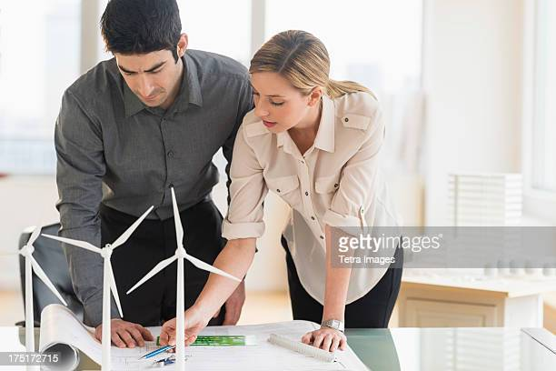 USA, New Jersey, Jersey City, Architects looking at scale models of wind turbines
