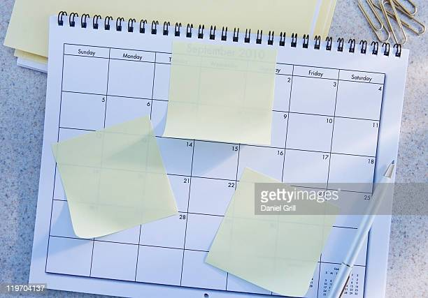 USA, New Jersey, Jersey City, blank adhesive notes on calendar
