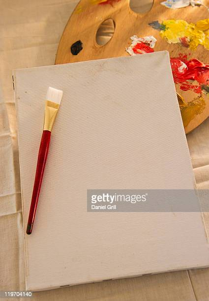 USA, New Jersey, Jersey City, blank artist's canvas, palette and paintbrush