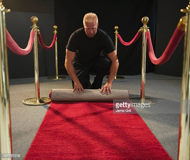 usa, new jersey, jersey city, bouncer rolling red carpet - doorman stock photos and pictures