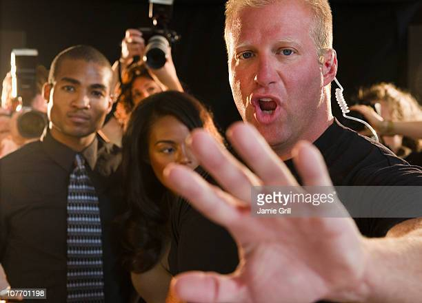 USA, New Jersey, Jersey City, Bouncer shielding celebrity at red carpet event