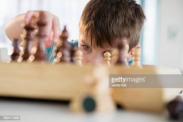 USA, New Jersey, Jersey City, Boy (4-5) playing chess