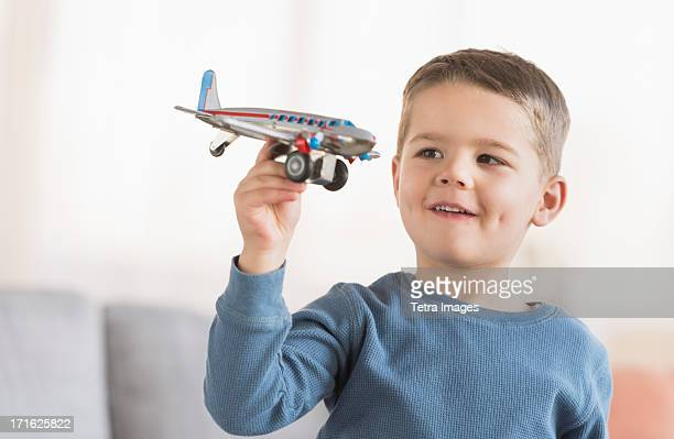 USA, New Jersey, Jersey City, Boy (4-5) playing with toy plane