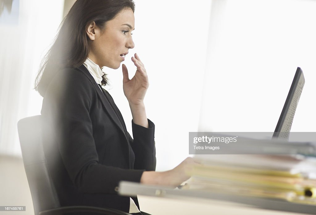 USA, New Jersey, Jersey City, Businesswoman using computer : Stock Photo