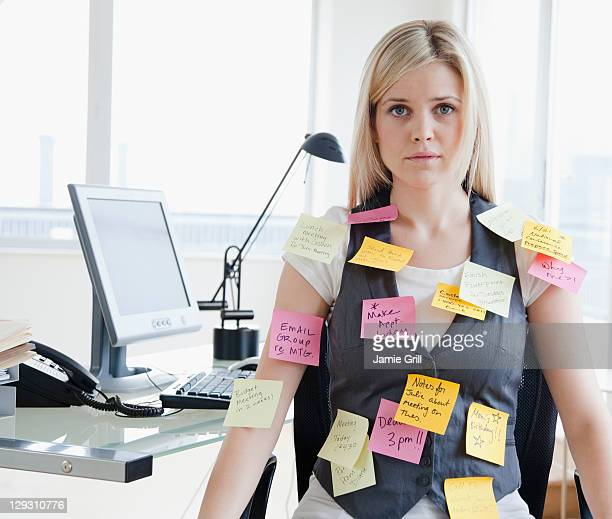 USA, New Jersey, Jersey City, Businesswoman with memo notes on clothes