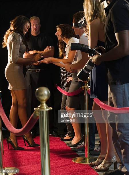USA, New Jersey, Jersey City, Celebrities signing autographs at red carpet event
