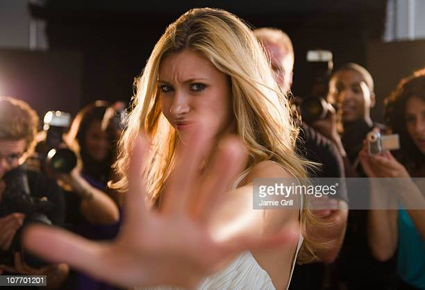 usa, new jersey, jersey city, celebrity blocking paparazzi at red carpet event - entertainment occupation stock pictures, royalty-free photos & images