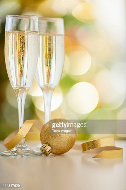 USA, New Jersey, Jersey City, Champagne glasses with christmas bulb