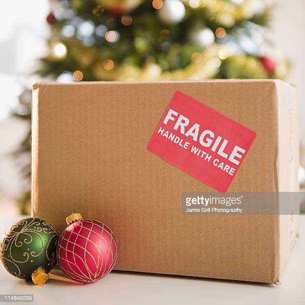 USA, New Jersey, Jersey City, Christmas baubles beside fragile box