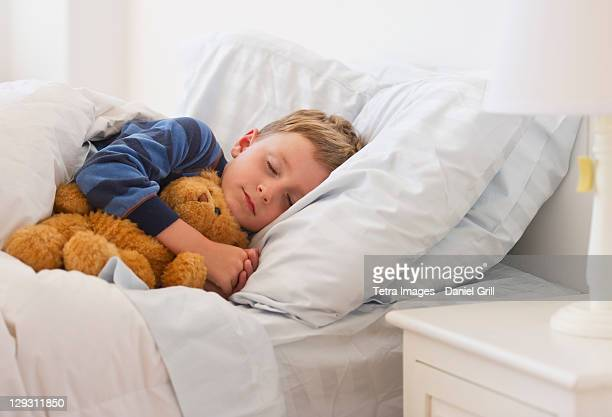 USA, New Jersey, Jersey City, Close up of boy (4-5) sleeping in bed
