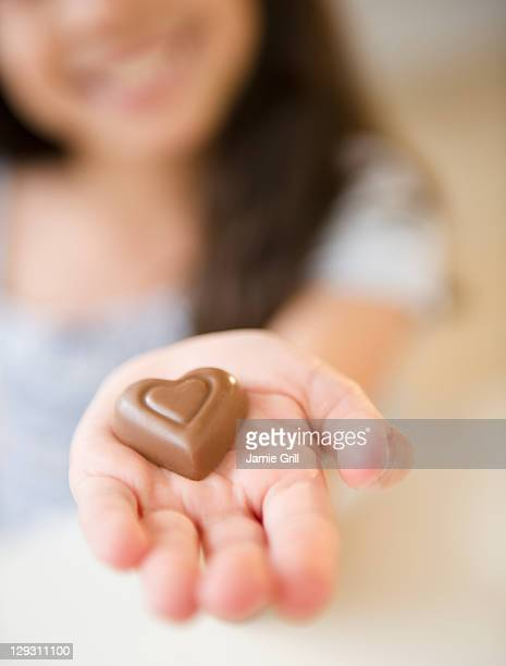 USA, New Jersey, Jersey City, Close up of girl's (10-11) hand holding chocolate heart