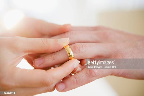 USA, New Jersey, Jersey City, Close up of man's and woman's hands with wedding ring