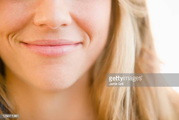 usa, new jersey, jersey city, close up of mouth of smirking woman - smirking stock pictures, royalty-free photos & images