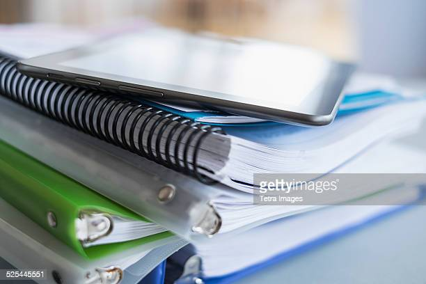 USA, New Jersey, Jersey City, Close up of stack of notebooks with digital tablet on top