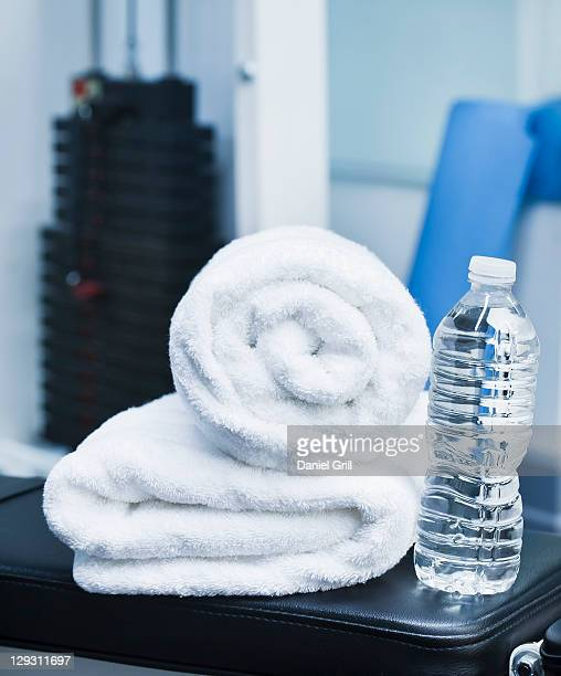 USA, New Jersey, Jersey City, Close up of towel and bottle in gym
